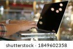 woman working with laptop on... | Shutterstock . vector #1849602358
