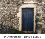 Old Stone Wall With  Doors From ...