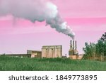Smoke From Chimneys Against A...