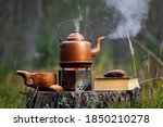 Copper Kettle On The Stove With ...