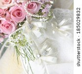 Wedding bouquet of roses and pearl necklace. - stock photo