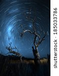 "Small photo of ""Due South"" nighttime landscape of star trails."