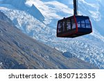 A Black And Red Cable Car Over...