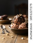 Small photo of Chocolate sorbet on the wooden background with space for text. Chocolate dessert. Chocolate ice cream