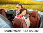 smiling couple sitting in the... | Shutterstock . vector #185122802