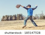 Boy Pitching A Baseball In The...