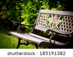 Iron Chair In A Green Garden