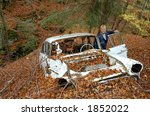 woman in old car wreck  autumn... | Shutterstock . vector #1852022