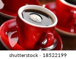 fresh brewed coffee in a red cup | Shutterstock . vector #18522199