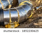Small photo of Laying of heating large diameter pipeline in the trench. Main district pipeline diverting.