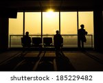 Silhouette Of People Waiting...