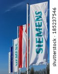 Small photo of VIENNA, AUSTRIA - March 30, 2014: Flags bearing the Siemens logo in front of their Austrian company headquarters. Siemens City is a campus-like complex with space for 6000 employees.