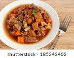 beef stew in white plate | Shutterstock . vector #185243402