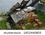 Pile Of Wood And Bricks In A...