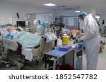 Doctors In The Protective Suits ...