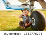 Funny Little Boy Traveler Sits...