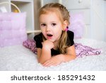 a little girl lying on the bed | Shutterstock . vector #185291432