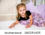 happy beautiful girl on a bed  | Shutterstock . vector #185291435