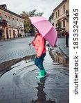 Child Holding Big Pink Umbrella ...