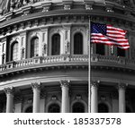 Stock photo united state capitol building for congress with american flag flowing in breeze and columns in 185337578