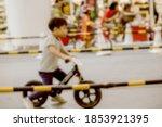 Blur Of Happy Little Boy On A...