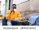 Black Man Drinking Coffee In A...