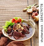 Small photo of A typical Palembang Indonesian dish, Malbi Sapi is a dish similar to Semur Daging but the seasonings have added tamarind and brown sugar, sometimes coconut milk. Selective focus.