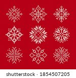 snowflakes on knitted pattern.... | Shutterstock .eps vector #1854507205