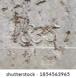 """""""1835"""" carved in stone – a detail an inscription produced that year"""