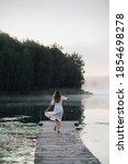 Woman In White Light Dress Run...