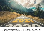 Small photo of 2021 New Year road trip travel and future vision concept . Nature landscape with highway road leading forward to happy new year celebration in the beginning of 2021 for fresh and successful start .