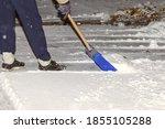 Snowy Winter Concept.shoveling...