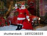 Santa Claus Poses Near A Red...