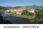 Decin historic town panoramic view with bridge across Labe River and Decin Castle on the hill, Czech Republic