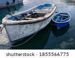 Kavarna, Bulgaria - September 2016: Large and small blue fishing boats lie next to each other in the harbor in the evening sun