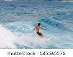 young man riding a surfboard in ... | Shutterstock . vector #185565572