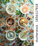 Porcelain Cups With Trinkets ...
