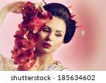 portrait of a japanese geisha... | Shutterstock . vector #185634602