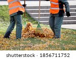 Janitors Sweeping The Fallen...