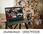 Virtual Christmas tree meeting team teleworking. Family video call remote conference. Laptop webcam screen view. Team meet working from their home offices. Happy hour party online woman team diversity - stock photo