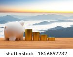 piggy bank and a pile of coins... | Shutterstock . vector #1856892232