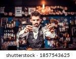 Bartender creates a cocktail at the alehouse