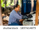 Older Women Dyeing Cotton With...