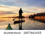 Silhouette Of Woman Paddle On...