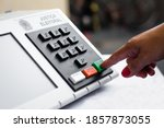 Small photo of November 20, 2020, Brazil. In this photo illustration a woman simulates a vote in the electronic ballot box used in the elections of Brazil