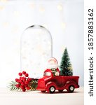 santa claus in a red car with a ... | Shutterstock . vector #1857883162