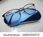 Eyeglasses With Blue Cloth...