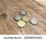 Few Euro Coins On Wooden Table