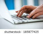 closeup of businesswoman typing ... | Shutterstock . vector #185877425