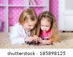 sisters using a tablet computer ... | Shutterstock . vector #185898125